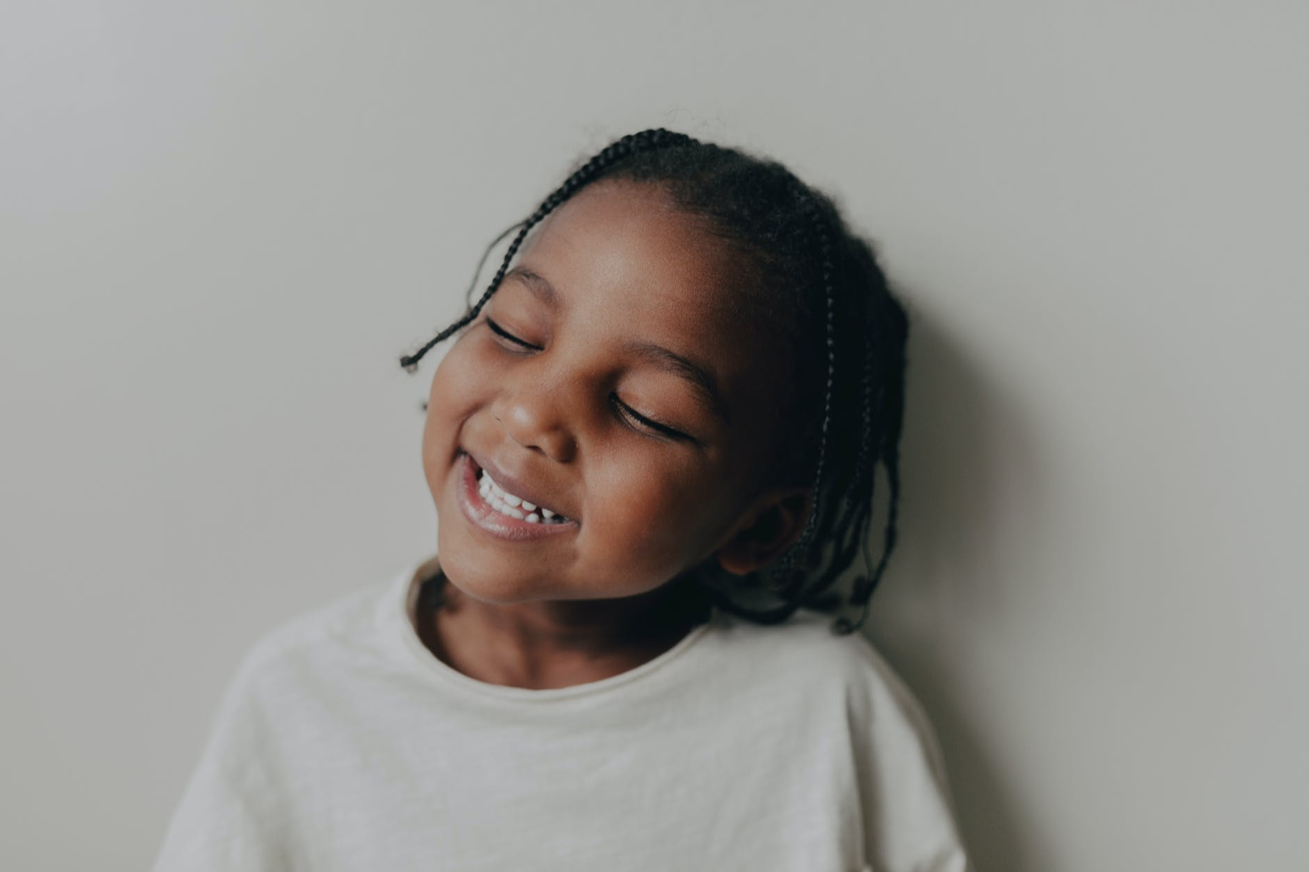 smiling girl in white crew neck shirt